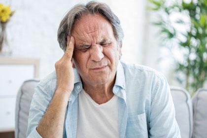 presnow - man holding head - stroke